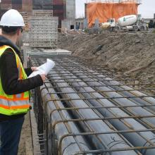 NAC individual inspecting electrical duct banks to be encased in concrete