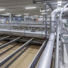 interior clarifiers tanks next process piping and walkway