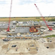 Aerial overview of jobsite with NAC team standing between two large cranes