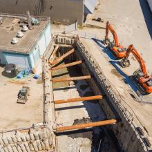 Aerial overview of shoring for building excavation
