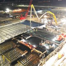 Night concrete pour for slab using pump truck