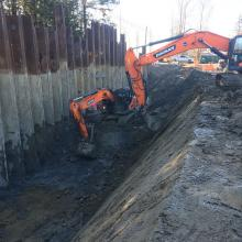excavation being completed next to shoring