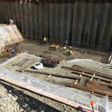 Rebar installation within excavation for base slab