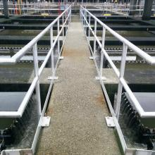 walkway with guardrail containing sedimentation tanks