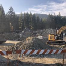 Excavators completing earthworks around site