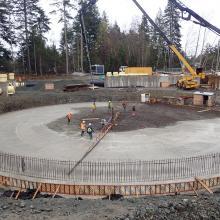 Concrete pump truck pouring a circular slab