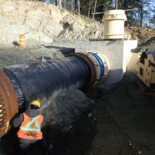 Pipe installation for manhole connection